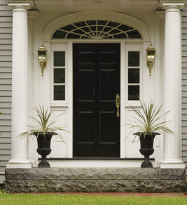 A formal entry look with container gardens.