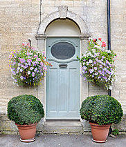 Container gardens impact your front entrance.